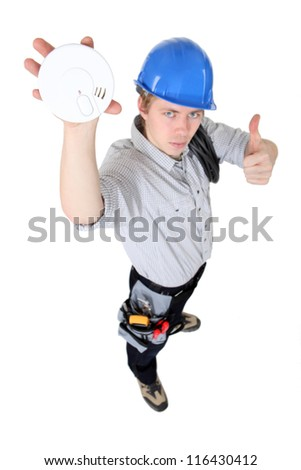 Tradesman approving of the use of smoke detectors - stock photo