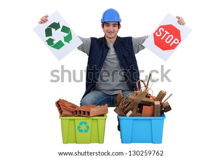 Tradesman encouraging recycling - stock photo