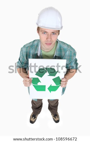 Tradesman holding a sign displaying the recycling symbol