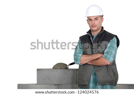 Tradesman standing by his work - stock photo