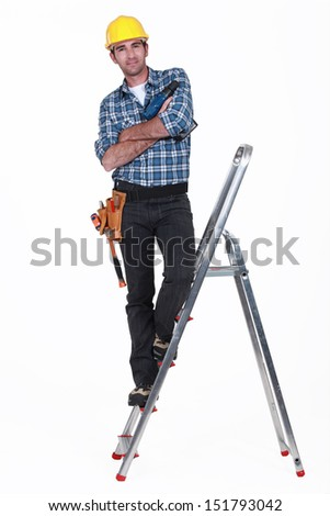 Tradesman standing on a stepladder - stock photo