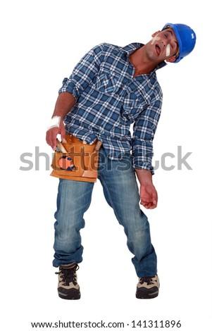 Tradesman suffering - stock photo