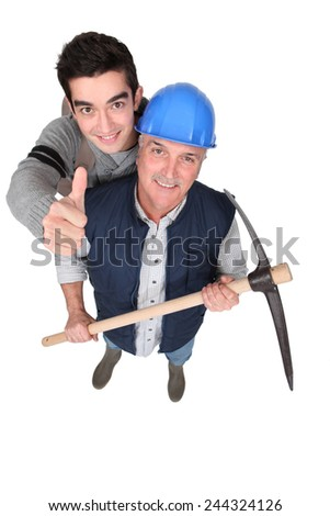 Tradesmen giving the thumb's up - stock photo
