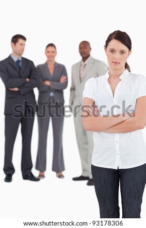 Tradeswoman with arms folded and three colleagues behind her against a white background