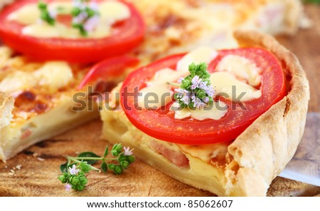 Tradition French bacon quiche with onion, tomato and cheese - stock photo