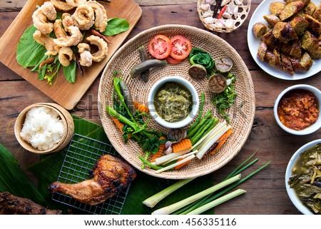 Tradition Northern Thai food. Thai cuisine nam prik or chili sauce, Thai sausages , deep fried pork skin. Thai food concept  - stock photo