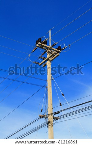 Traditional above ground high voltage pole and lines - stock photo