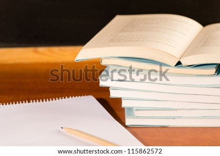 Traditional academical study school books on wooden desk - stock photo