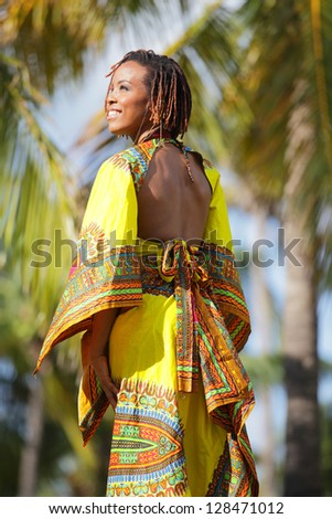 Traditional African American woman smiling - stock photo
