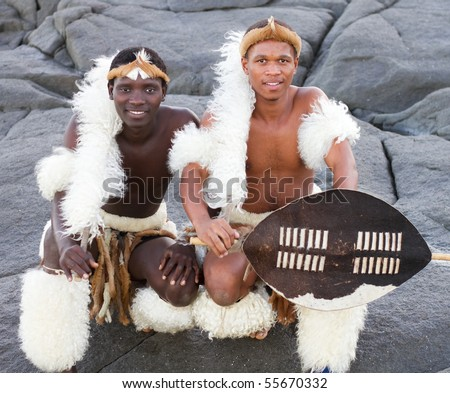 traditional african men on beach - stock photo