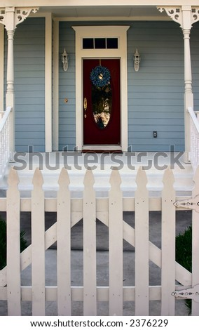 traditional american front porch with white picket fence - stock photo