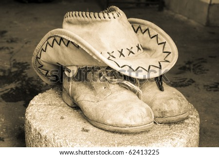 Traditional American hat of cowboy and old dirty  boots - stock photo