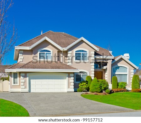 Traditional american home with double doors garage in the suburbs of Vancouver - stock photo