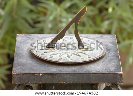 Traditional ancient roman sundial clock in the park - stock photo