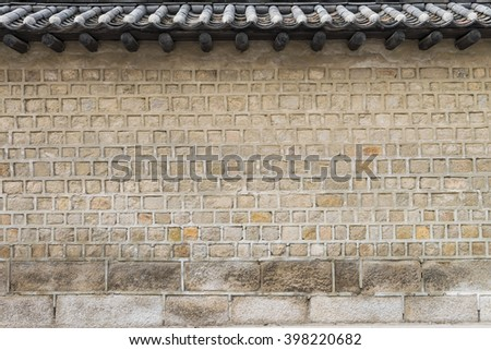 Traditional Ancient stone wall and ceramic roof pattern and background, Korean style. - stock photo