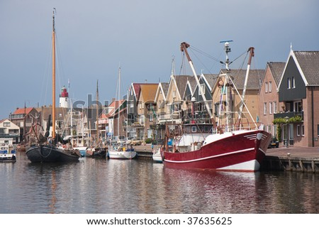 Traditional and modern fishing cutter in the harbor of Urk, the Netherlands - stock photo