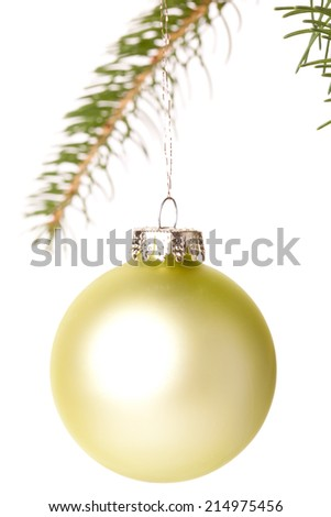 Traditional  and shiny Christmas ball hanging from a branch of a green fir tree, with copy space on white
