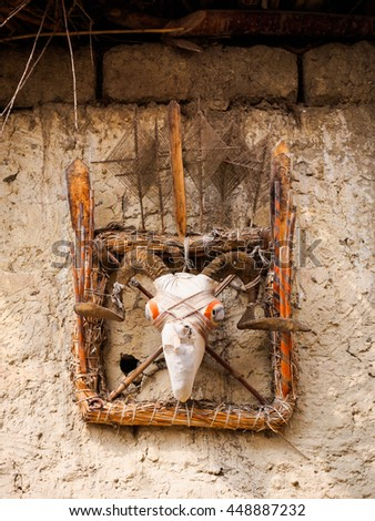 Traditional animist spirit catcher made from cloth-covered goat skull in Mustang, Nepal - stock photo