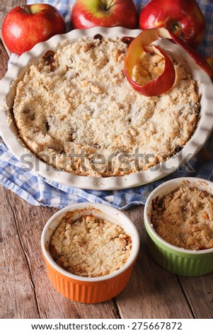 Traditional apple crisp close-up in baking dish. Vertical, rustic style