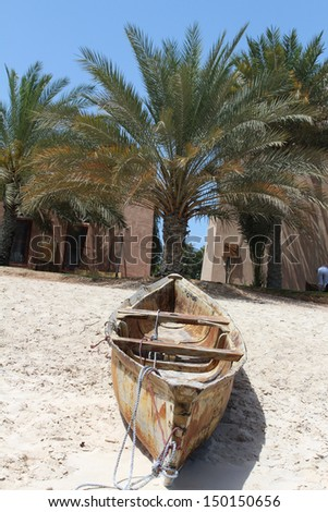 Traditional arabian boats on the beach of Abu Dhabi, United Arab Emirates - stock photo