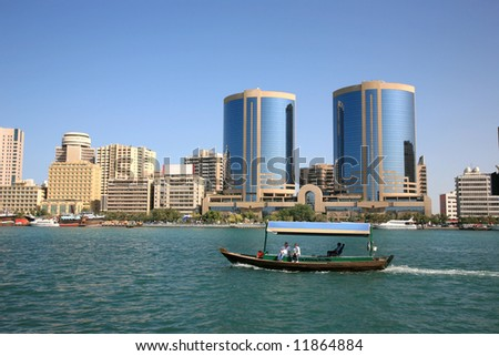 Traditional arabian wood boat still use for transport passenger in Creek Dubai - stock photo