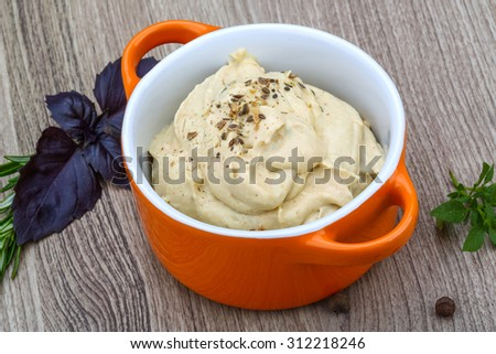 Traditional arabic cusine - hummus with herbs, olive oil and spices