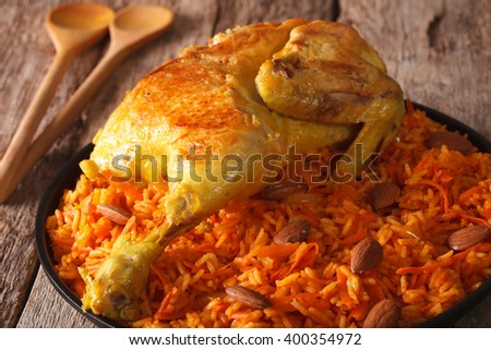 Traditional Arabic food: kabsa with chicken closeup on a plate. Horizontal