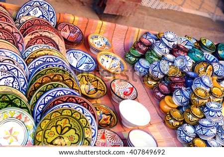 Traditional arabic handcrafted, colorful decorated plates shot at the market - stock photo