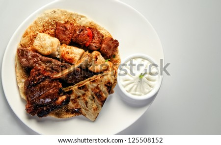 Traditional Arabic mixed barbeque plate. - stock photo