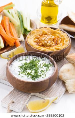 traditional Arabic sauce - hummus and yogurt with herbs, top view - stock photo