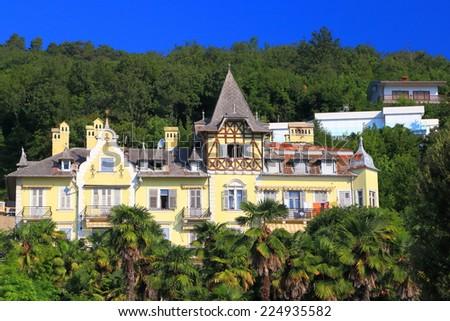 Traditional architecture on a hillside resort near the Adriatic sea, Opatija, Croatia - stock photo