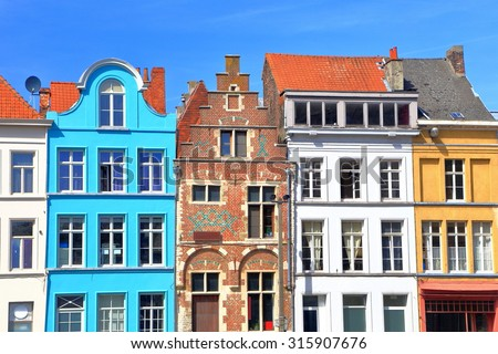 Traditional architecture with vivid facade of tall houses in Ghent, Belgium - stock photo