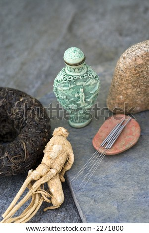 Traditional asian health items:black tea, ginseng, acupuncture needles, and medicine jar. - stock photo