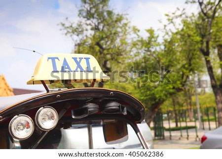 Traditional asian rickshaw vehicle parked on the road. Close up - stock photo