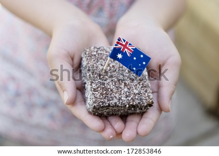 traditional Australia food for Australia Day, lamington with flag - stock photo