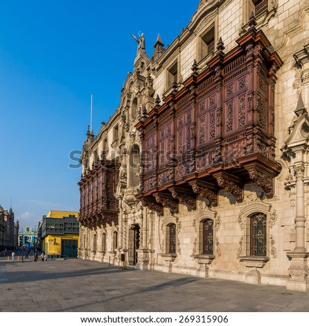 Traditional balcon of  archiepiscopal palace in Lima, Peru. - stock photo