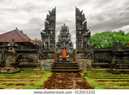 Traditional balinese architecture. Gate of temple. - stock photo