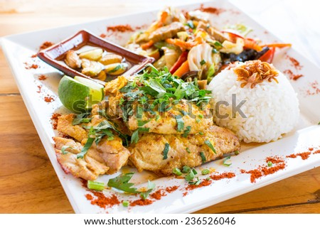 Traditional Balinese cuisine. Vegetable stir-fry, fish and rice. - stock photo