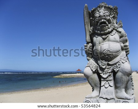 traditional balinese statue on sanur beach, bali, indonesia - stock photo