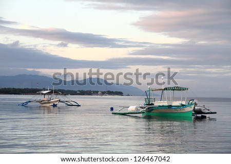 "Traditional ""Bancas"" at sunset, Cebu, Philippines - stock photo"