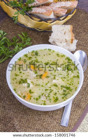 traditional barley soup in a white bowl with bread - stock photo