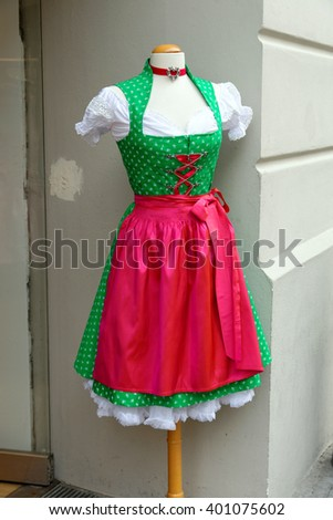 Traditional Bavarian dirndl on display, for sale, in Munich, Germany. - stock photo
