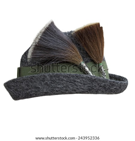 "Traditional bavarian felt cap with two brown and black ""Gamsbarts"", isolated on white background - stock photo"