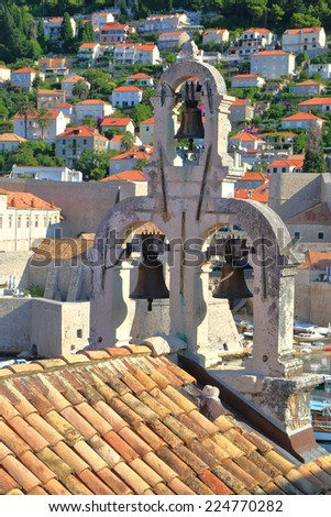 Traditional bell tower and roof of a church in the old town of Dubrovnik, Croatia - stock photo