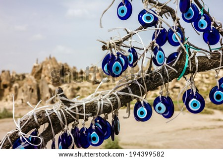 Traditional blue evil eyes. Tree with popular Turkish souvenir. - stock photo