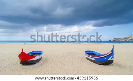 Traditional boats at Portugal, city Nazare - stock photo