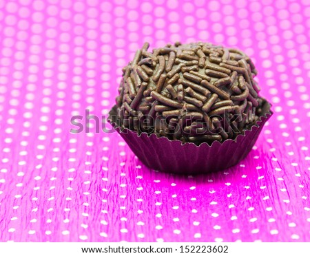 Traditional Brazilian Brigadeiro on Pink background