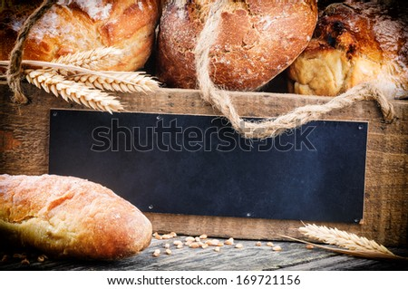 Traditional bread and wooden board with copyspace  - stock photo