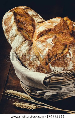 Traditional bread in basket  - stock photo