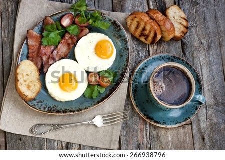 Traditional breakfast with coffee , fried eggs and toast - stock photo